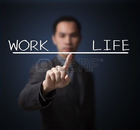 14302170-business-man-balance-his-work-and-life-by-finger-tip