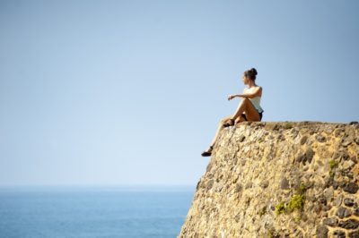 woman cliff alone pexels