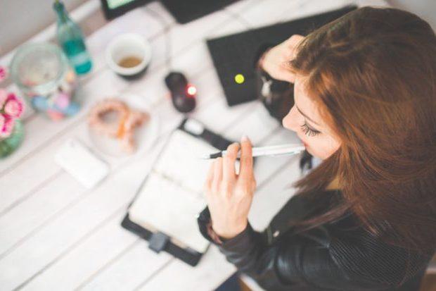 woman-hand-desk-office pexels